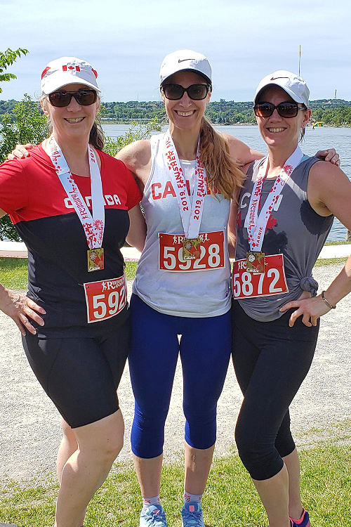 three women posing after a race on Canada Day